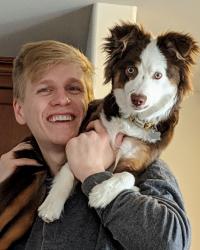 Andy Goldschmidt and his mini Australian shepherd, Susie.