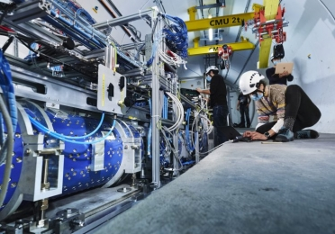 Researchers working to install the FASER detector at CERN.