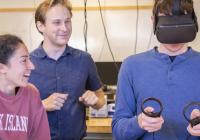 A physics student wears an immersive headset to attempt a physics experiment in virtual reality.